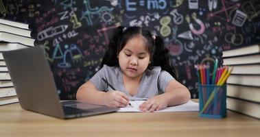 Girl Enjoys Art on Paper in Classroom video