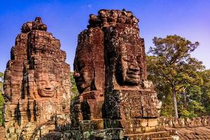 Stone Reliefs head on towers at the Bayon Temple in Angkor Thom photo