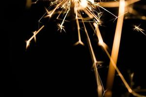 Christmas and newyear party sparkler on black photo