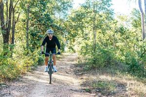 Cyclist Riding the Bike on the Beautiful Spring Mountain Trail photo