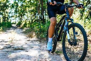 The man riding a bike in a mountain path photo