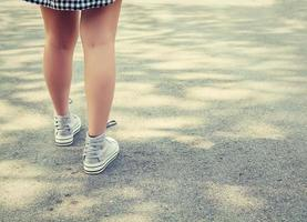 Woman feets walking in the park photo