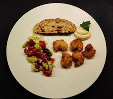 Fresh roasted shrimps and vegetables photo
