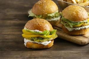 Arrangement with delicious vegan burger photo