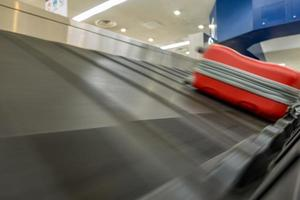 baggage claim conveyor belt at the airport photo