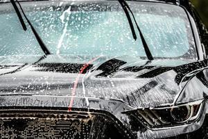 washing car with foam in summer photo