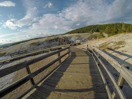 Old Faithful geysersac at Yellowstone National Park photo