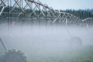 Irrigation equipment on farm field on sunny day photo