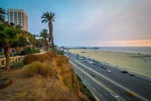 scenes around santa monica california at sunset on pacific ocean photo