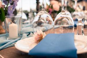 Wedding or event decoration table setup, blue clolor photo