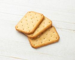 Cracker cookies on white wooden table background photo