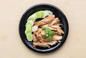 Grilled chicken in black dish photo