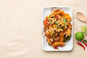 Chicken with cashew nuts, famous food in Thailand photo