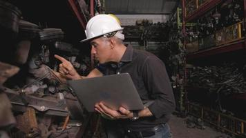 Two Men Checking Engine Parts in A Warehouse video