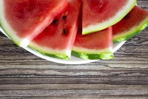 Watermelon on a wooden plan. Slices of ripe watermelon photo