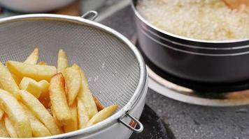 Frying french fries in the fryer in hot oil. video