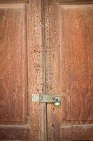 vintage wood door of thai style house photo