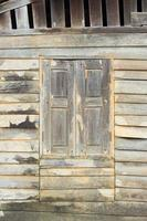 Texture of Asian style old wood house wall. photo