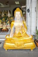 buddha wrapped in plastic photo
