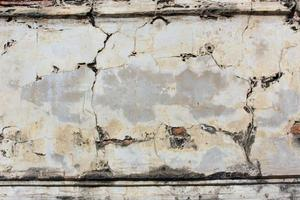 Grunge concrete cement wall with crack photo
