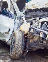 Crashed car close up. The front part is severely damaged. photo