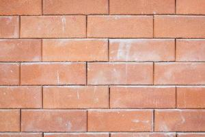 closeup of old red brick wall texture photo