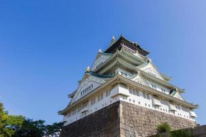 Osaka castle on clear blue sky with copyspace photo