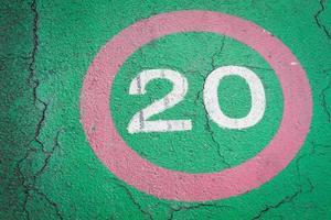 speed limit sign 20 kilometers on bike lane photo