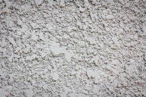 Fondo de textura de pared de hormigón de explosión de arena irregular foto