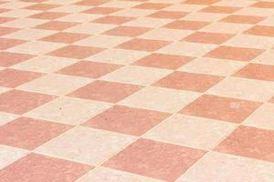 old and pale ceramic tiled floor of temple in thailand, outdoor. photo