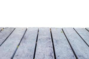 empty wooden perspective with small leaves photo