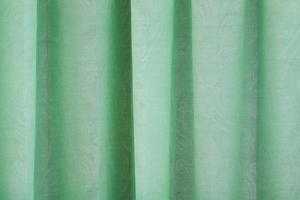 Vista cercana de la cortina verde brillante foto