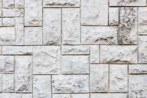 Muro de piedra pizarra o trama de fondo con textura de ruta foto