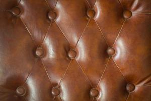Textura de cuero marrón del tiro del primer del sofá. foto