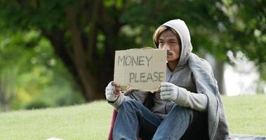 Homeless Man Sitting and Holding Money Please Sign video