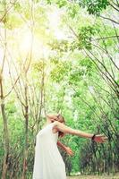 young asian woman stretch her hands in fresh air look so comfortable. photo