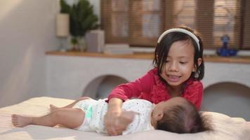 Asian Teenage girl with infant while playing together at home video