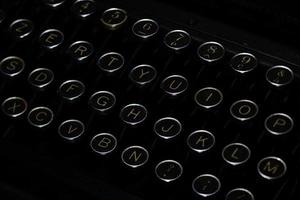 Keys with letters of ancient black typewriter photo