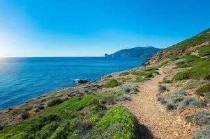 Island of Sardinia in Italy footpath on the sea photo