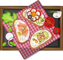 Top view of different bruschettas on wooden tray isolated vector