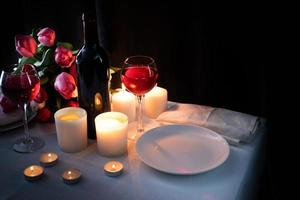 Romantic Candlelight Dinner for Two Lovers, dark background photo