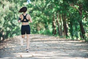 Young fitness woman jogging in park. photo