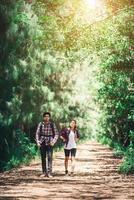 Couple trekking adventure holiday together. photo