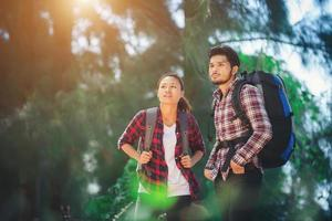 Young couple go adventure hiking together on vacation. photo