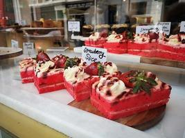 strawberry cake on a counter show window photo
