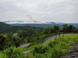 Road turning in the mountains with landscape in the morning photo