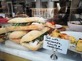 sandwich on a counter show window in Portobello Market, Notting Hill. photo