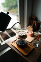 drip coffee in house,Pouring a hot water over a drip coffee photo