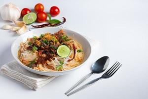 Rice noodles in fish curry sauce with vegetables photo