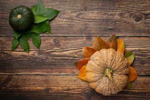 pumpkin placed on wooden floor concept hello september photo